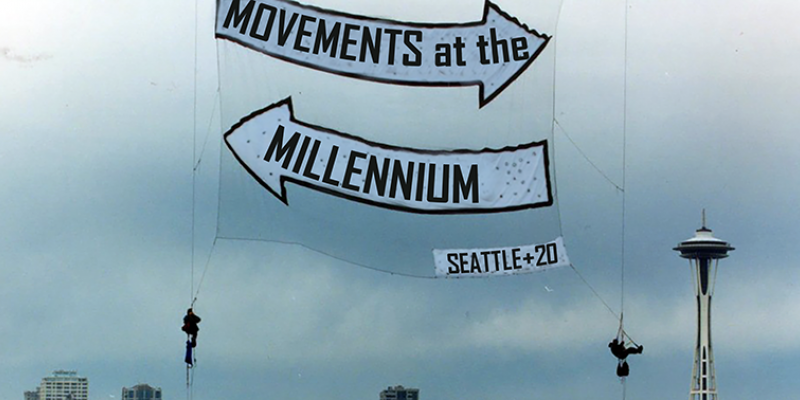 Photo of a Rainforest Action Network banner drop over Seattle, November 1999